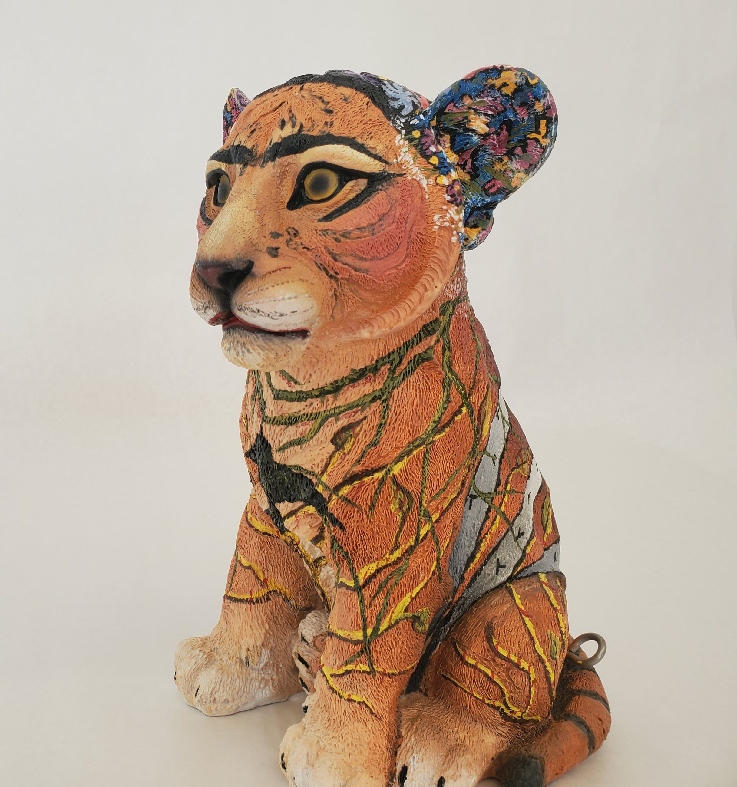 Tiger cub painted in the style of Frida Kahlo