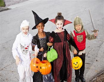 Children dressed in Halloween costumes.